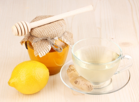 Healthy ginger tea with lemon and honey on wooden background Stock Photo - 13681258