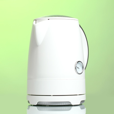 White electric kettle on green Stock Photo - 13790923