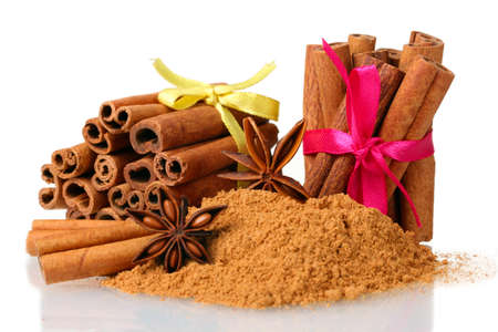 Cinnamon sticks, powder and anise isolated on white photo