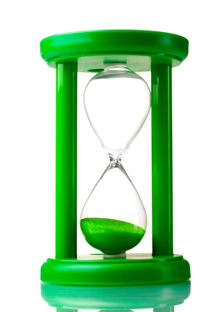 green hourglass isolated on white photo