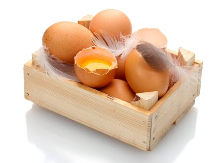 chicken eggs in wooden box isolated on white photo