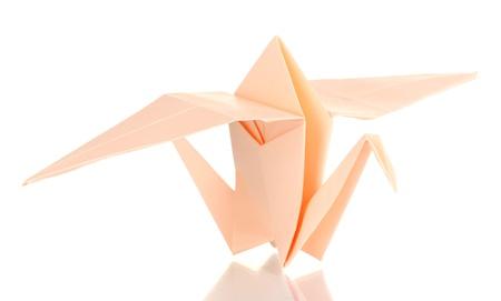 origami paper crane isolated on white photo