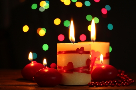 Beautiful candles on wooden table on bright background Stock Photo - 13791552