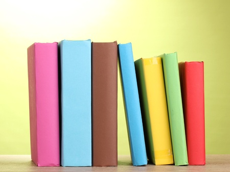secretary tray: Books staying on wooden table on green background
