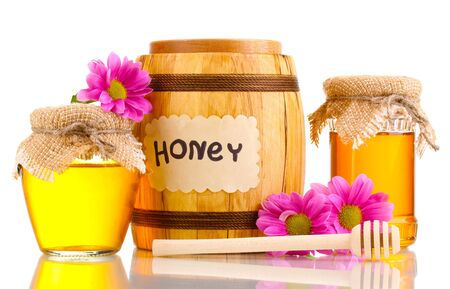 Sweet honey in barrel and jars with drizzler isolated on white Stock Photo - 13793515