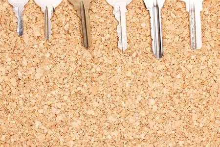 Keys on cork background photo