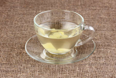 Healthy ginger tea on sackcloth photo