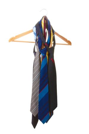 bright ties on wooden hanger isolated on white Stock Photo - 13791006