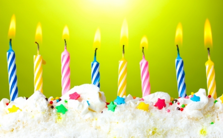 beautiful birthday candles  on green background photo