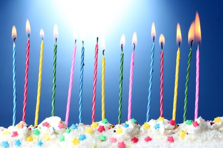 beautiful birthday candles  on blue background photo