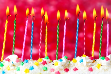 beautiful birthday candles  on red background photo