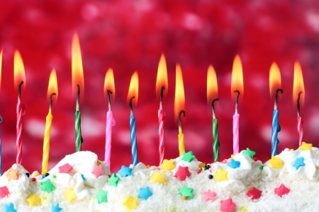beautiful birthday candles  on red background Stock Photo - 13796372