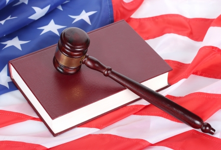 judge gavel and book on american flag background Stock Photo - 13796833