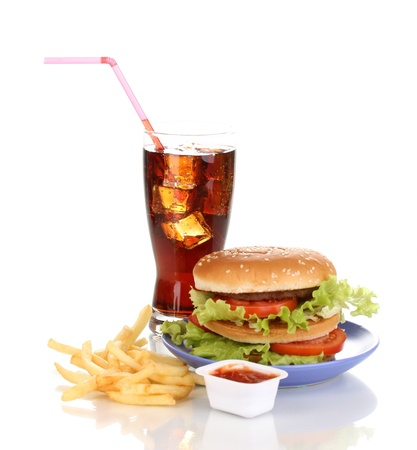 Big and tasty hamburger on plate with cola and fried potatoes isolated on white photo