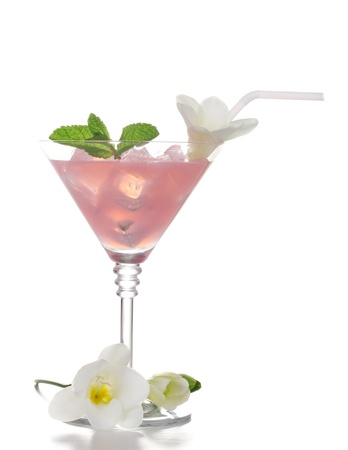 martini glass of cocktail with ice and flowers isolated on white photo