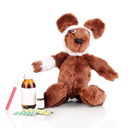Sick bear wrapped with bandage isolated on white Stock Photo - 13791199