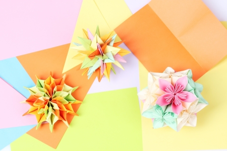 Colorfull origami kusudamas on bright paper background photo