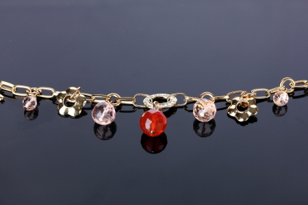 Beautiful golden bracelet with precious stones on grey background Stock Photo - 13796371