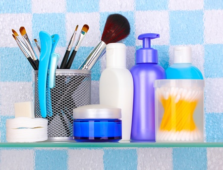 Shelf with cosmetics and toiletries in bathroom Stock Photo - 13796499