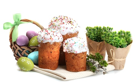 Beautiful Easter cakes, colorful eggs in basket and pussy-willow twigs isolated on white Stock Photo - 13793451
