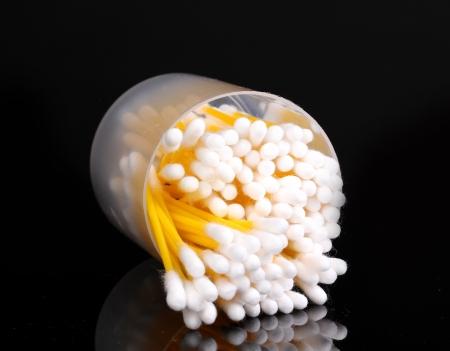 Cotton ear sticks isolated on black photo
