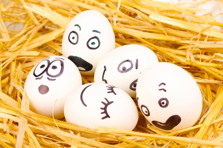 dodger: White eggs with funny faces in straw