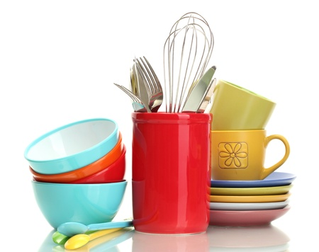 bright empty bowls, cups and kitchen utensils isolated on white Stock Photo - 13818806
