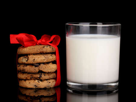 Glass of milk and cookies isolated on black Stock Photo - 13819707