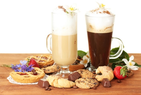 glasses of coffee cocktail on wooden table with sweet and flowers on white background Stock Photo