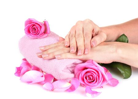 Pink towel with roses and hands on white background Stock Photo - 13819924