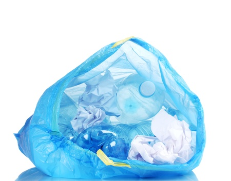 open blue garbage bag with trash isolated on white photo
