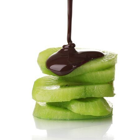 blanketed: ripe kiwi with chocolate isolated on white
