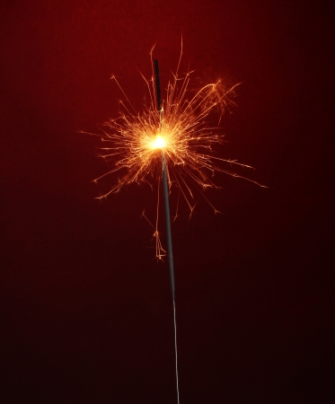 beautiful sparkler on red background photo