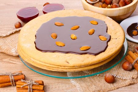 cake on glass stand and nuts on wooden  table Stock Photo - 13822083