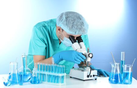 scientist in the lab working with microscope Stock Photo - 14953971