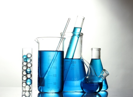 Test-tubes with blue liquid isolated on white Stock Photo - 13819624