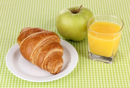 Classical breakfast. Orange juice and croissant photo