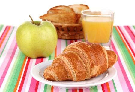 Classical breakfast. Orange juice and croissant photo