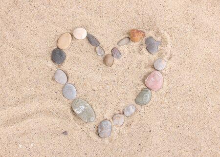 Love-stones on sand photo
