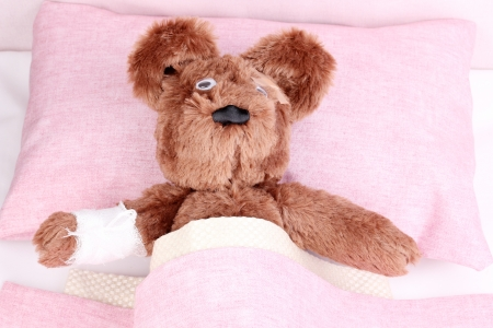 Sick bear in bed Stock Photo - 13822073