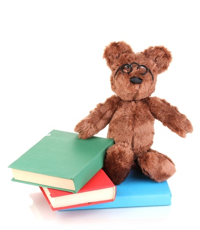 Sitting bear toy with books isolated on white Stock Photo - 13818844