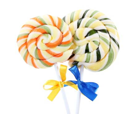 Colorful lollipops with ribbons isolated on white photo