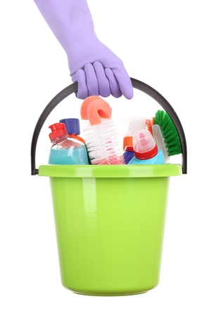 Bucket with cleaning items in hand isolated on white photo