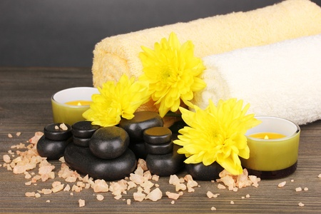 Spa setting on wooden table on grey background Stock Photo - 13821605