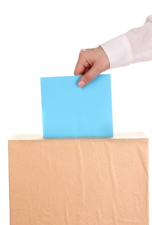 Hand with voting ballot and box isolated on white Stock Photo - 13820010