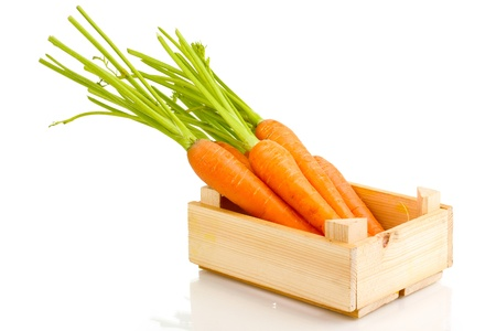 wooden box: Carrots in crate isolated on white