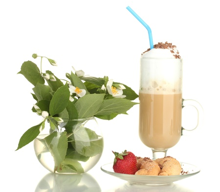 glass of coffee cocktail with croissants and strawberry on saucer and vase with flowers isolated on white photo
