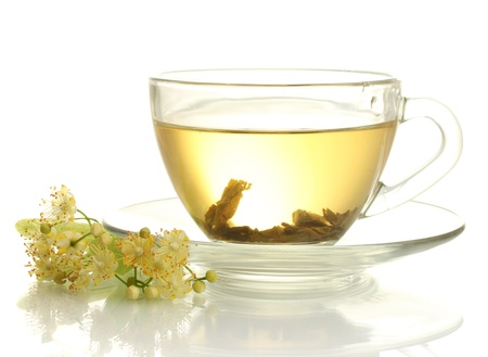 cup of linden tea and flowers isolated on white photo