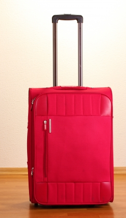 Red suitcase in the room photo
