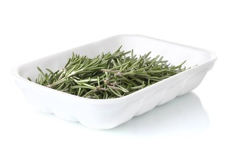 lavage: fresh green rosemary in the package isolated on white